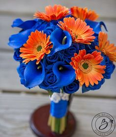 Sweet Dreams in Tangerine Royal blue and orange Real Touch wedding bouquet with gerber daisies, calla lilies, and roses - Ready to ship  Beautiful fresh looking bouquet, but in colors that cannot be matched as perfect in the real world. This bouquet will match your blue and orange wedding colors to perfection. Its YOUR day you shouldnt have anything less! Soft thin petals on roses will have your guests in awe, calla lilies perfectly tuck in between, and gerbera daisies delicately laying on…