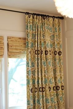 I like these Bamboo roman shades paired with the curtains for the living room, and maybe kitchen too.