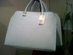 A chick and cute pastel blue H&M bag - I want!