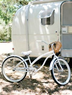 White vintage camper........and lovely bike to match:) Think I'll paint my bike to match my tent!