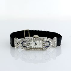 Ladies Art Deco Diamond and Sapphire Ribbon Watch, 1920's.........