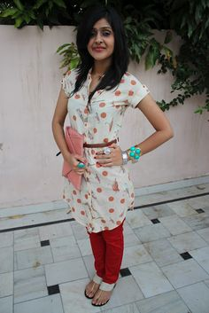 bird print+polka dot tunic, red skinnies, some coral and turquoise jewelry