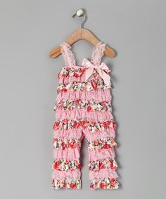 A delicate bow accent and layers of frilly ruffles make this sweet jumpsuit the perfect outfit for a living room dance recital. A spirited sleeveless cut means a girl will have freedom to make the best possible twirls.Polyester / nylonHand wash; hang dryImported