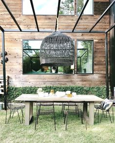Hello and welcome to our modern black home! I frequently have people inquire about our house, curious about how… Outdoor Dining Set, Outdoor Rooms, Outdoor Furniture Sets, Outdoor Decor, Outdoor Chandelier, Pendant Chandelier, Black Chandelier, Backyard Plan, Backyard Garden Design
