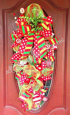 Christmas Candy Swag by aDOORableDecoWreaths on Etsy Christmas Swags, Christmas Door, Christmas Candy, Christmas Time, Christmas Decorations, Christmas Things, Christmas Ideas, Xmas, Deco Mesh Crafts