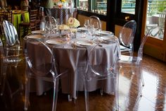 Shilshole Bay Beach Club Wedding Tasting Event - ghost chairs with gray table and white flowers