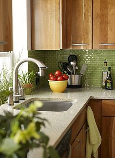 kitchen tile and cabinets-emerald green base cabinets, black and