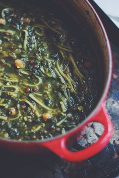 """Ash Reshteh,made with herbs,legumes,and noodles is the most popular  &famous """"thick soup""""across all regions of Iran, especially during  winter.It is also one of the main dishes of Norooz(Persian new year -  starts 20-21st march). It is very similar to the Italian Minestrone."""
