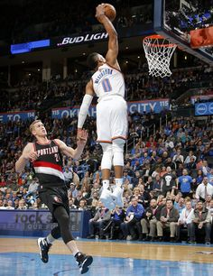 Oklahoma City's Russell Westbrook (0) dunks in front of Portland's Mason Plumlee (24) during an NBA basketball game between the Oklahoma City Thunder and the Portland Trail Blazers at Chesapeake Energy Arena in Oklahoma City, Wednesday, Dec. 16, 2015.  Photo by Bryan Terry, The Oklahoman