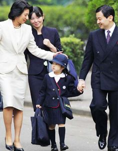 Princess Masako fussing over little Princess Aiko on her first day at school.