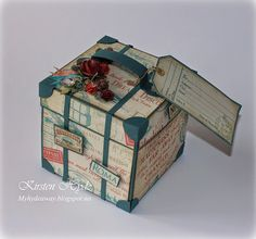 The Dragon Explosion travel trunk card. Made with Graphic 45 papers, Come Away with me collection. When you open the trunk, a flying origami dragon appears over a little mountain in the water. Made by Kirsten Hyde.