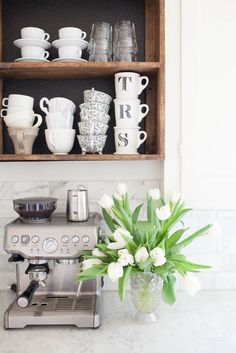 Open shelving is so dreamy. And we love this mug collection, too.