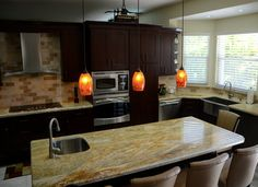 KabCo Kitchens designed this cherry Showplace and we're happy they did! Featured here, our Cordova stain! Beautiful work in Florida!  Learn more about KabCo Kitchens: http://kabcokitchens.com/ Learn more about our stain offerings on cherry: http://www.showplacewood.com/WoodsFin2/woodsC.0.html