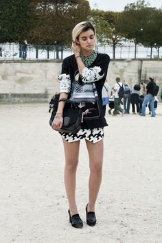 She worked a bold print mix and an even bolder necklace. #PFW