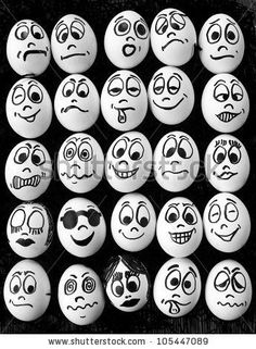 stock photo : White eggs and  many funny faces