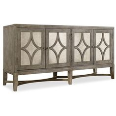 Features:  -Melange collection.  -Constructed of hardwood solids and cherry veneers with antique mirror.  -Two air of doors with one adjustable wood shelf behind each.  -Can be used as a TV stand .  B