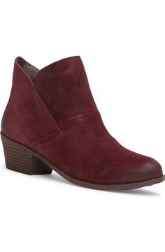 Overlapping panels form the clean-lined silhouette of this go-to ankle bootie…