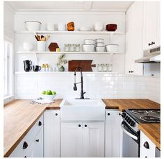 butcher block countertops+subway tile+sunk in sink+white cabinets+open shelving+dark cup pulls= My perfect dream kitchen