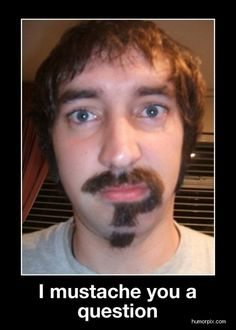 Bahahaha!  I just realized his mustache/beard is in a shape of a question mark!  Ha!  That's great!