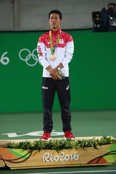 Kei Nishikori Photos Photos - Bronze medalist Kei Nishikori of Japan poses during the medal ceremony for the men's singles on Day 9 of the Rio 2016 Olympic Games at the Olympic Tennis Centre on August 14, 2016 in Rio de Janeiro, Brazil. - Tennis - Olympics: Day 9