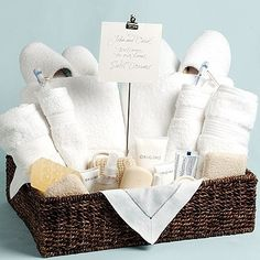 Fill a basket with necessities such as bath and face towels, washcloths, and soap, shampoo, as well as luxury items such as slippers, a robe, lotions, and a loofah. Place the basket in the guest room.