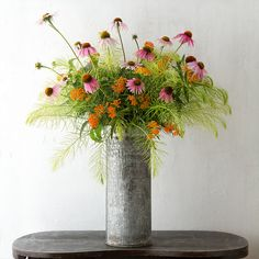 """Made from reclaimed metal, this tall, narrow vase makes a rugged vessel for dramatic displays of branches.- Reclaimed metal- Indoor or outdoor use- Imported18.5""""H, 8"""" diameter"""