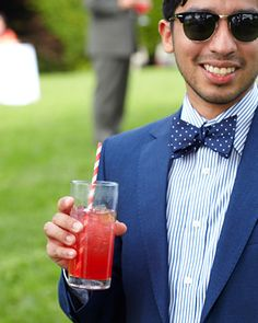 Playful Pomegranate . Guests drank pomegranate champagne with red striped straws at this New York wedding.