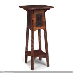 LIMBERT Charles, Limbert arts and crafts furniture co, act. 1910 (USA)  Title : Plant stand   Date :      Category : 20th Century Decorative Arts  Medium :    : desirable form with a square top over an inlaid ebony and caned base over a lower shelf, original cane