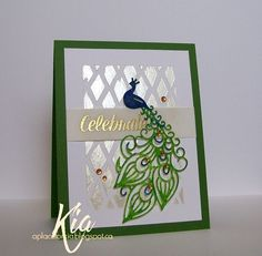 I used the Fancy Peacock die from Frantic Stamper. For the background I stenciled using satin embossing paste and added a vellum border stamped in gold embossing powder using the Celebrations stamp set. I added a few gems amongst the feathers and card to finish.