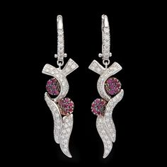 Favero 18Kt White & Rose Gold Diamond & Pink Sapphire Earrings feature 106 Round Cut Diamonds for approximately 0.53cts set with 24 Round Cut Pink Sapphires for approximately 0.12cts.  Earrings measure 11mm x 40mm and weigh 7.27 grams.