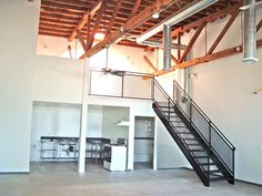 Transit Lofts- Ontario Art District Lofts in Downtown Ontario, Ca. Live/Work loft. Loft living. Industrial style kitchen. Industrial living. Exposed beams, vents and piping. Metal staircase. Concrete floors. Skylights. Open concept. Modern living. Jeved Management, Inc.