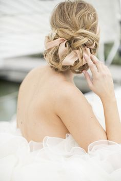 A pretty chignon with ribbon woven into it: http://www.stylemepretty.com/little-black-book-blog/2014/07/08/seaside-garden-wedding-inspiration/ | Photography: Alicia Pyne - http://www.aliciapyne.com/