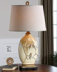This One Light Table Lamp is part of the Pajaro Collection and has a Gilded Gold Finish with the scenery of birds perched on a branch on the vase.: Y4ED | Dulles Electric Supply Corp.