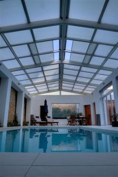 This retractable roofing system over a private residential pool is a double pitch featuring 2×12 bays. The pool cover was built over a structural aluminum system with remote control motorized retractable roofing. The glazed in 16mm triple wall Solar Control (SC) PC glazing allows the owners of this inground pool to enjoy its comforts all year.  The complete system  was supplied by Libart and sold and installed by CoverIt in Malta.
