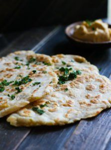 Grain Free Naan Bread with Cassava Flour! A simple and flavorful Middle Eastern bread made grain free and in 20 minutes or less! No oven required, just a skillet and few simple ingredients. Great with hummus, yogurt sauce, or by itself. Definitely a staple recipe you'll want to make over and ov...