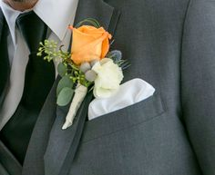 This boutonniere is perfect for a fall wedding.