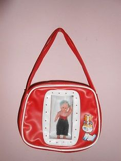 Vintage-childs-toy-purse-celluloid-doll-in-display-window