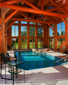 This large pool space is created by structural log trusses and log purlins. The ceiling heights soar and the large panels of glass give you the feeling you are swimming outdoors.