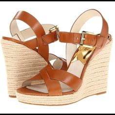 "🎉SALE PRICE🎉  MICHAEL  KORS SANDALS💞 Michael Kors brings sexy and fun back with this fresh espadrille style . Cover all fashions this spring. Braid-embossed wrapped with a leather crisscrossing platform wedge. Heel 4.75"". Runs small. Michael Kors Shoes Sandals"