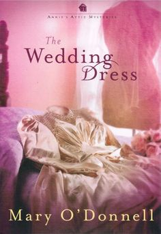 The Wedding Dress Annie's Attic Mysteries Mary O'Donnell 2011 Hardcover Book 11 | Annie Dawson's attic in Grey Gables has divested itself of many treasures since she inherited the home in Stony Point, Maine, from her grandmother. But none has been as romantic and mysterious as the beautiful wedding dress with a handcrafted veil and a pair of formal gloves that she finds gracing an old mannequin concealed beneath a sheet. | Good easy read.