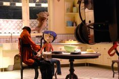 stop motion puppets in action, from a behind the camera perspective.