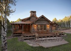 Gorgeous Log Home with Wrap Around Porch This is the basic shape, gable roof with small addition on east end,cottage scale, wrap around porch.