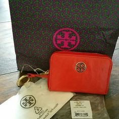 Tory Burch Dana wallet *New* Tory Burch Dana blood orange wallet new with tags and gift bag. Inside has divided section. Can be used as small wallet or coin. Ziparound leather with emblem on front. Keyring. Attached Tory Burch Bags Wallets