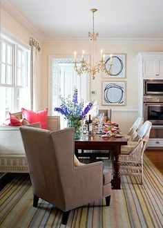 kitchen banquette, not built in for eat in kitchen area, striped rug in pink yellow blue