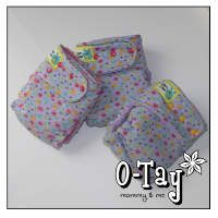 Purple diapers with butterflies and flowers.  Ai2 (all-in-two) and hybrid fitted.