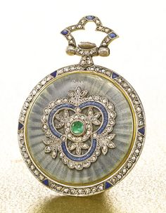 MARCUS & CO. A SLIM PLATINUM, DIAMOND AND ENAMEL DRESS WATCH CIRCA 1890 • jeweled gilt lever movement • silvered engine-turned dial, Arabic numerals • case back with translucent blue enamel over an engine-turned ground, centered by a cabochon emerald and intricate diamond-set decoration, both bezels and bow set with diamonds and interspersed with blue enamel triangles • dial signed