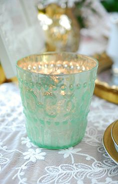 5.99 SALE PRICE! With its hobnailed detail and vintage design, theMercury Glass Votive Holder in Light Green brings antique sophistication to its surroundin...