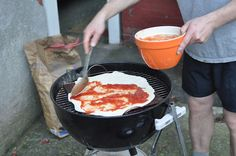 Pizza Baked on your Grill (good tips, like how to arrange your hot coals to lessen risk of scorching; you'll need a grill, charcoal, unfinished ceramic tiles [your makeshift baking stone], and uncooked pizza [recipe provided])