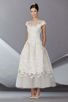 Carolina Herrera's tea-length cap sleeve wedding dress is so Audrey Hepburn.