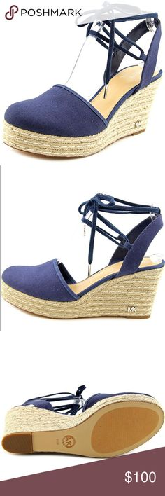 Michael Kors Margie Denim wedges Barely worn Michael Kors Margie Denim wedges, heel height 3 1/2, canvas wedges with closed toe and laceups Michael Kors Shoes Wedges